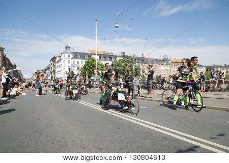 Copenhagen, Denmark - May 22, 2016: Runners with wheelchairs at the yearly event Copenhagen Marathon.