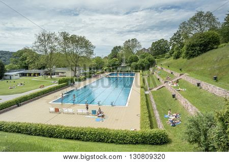 BADEN-BADEN, GERMANY  - MAY 22, 2016: Summer swimming pool in Baden-Baden. Summer swimming pool popular destination family recreation.