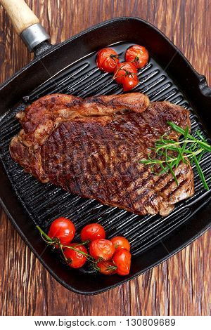 Grilled Beef Sirloin Steak on iron pan with vegetables