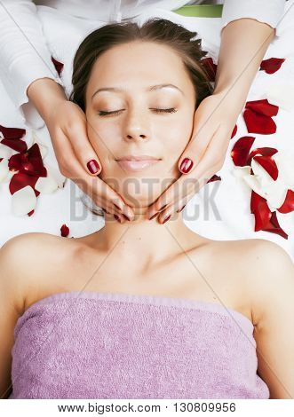 stock photo attractive lady getting spa treatment in salon, massage doctor smiling care pretty, beauty red manicure