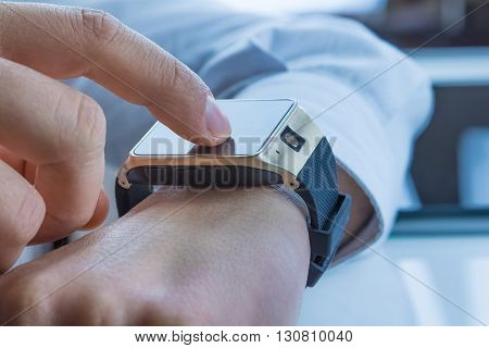 Business Man Using His Smartwatch App On Daily Light