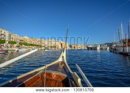 rowing boat at malta harbor under blue sky