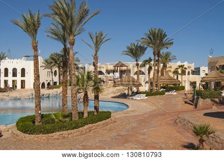 Hotel In Egypt With A Swimming Pool With Sun Loungers