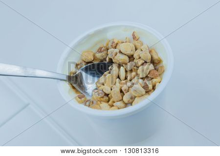close-up of healthy cereal and chocolate and white yogurt on the spoon concept of healthy food nutrition