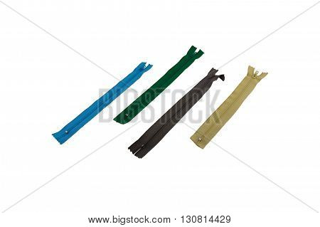 macro four multi-colored zipper locks of a fastener isolate on a white background