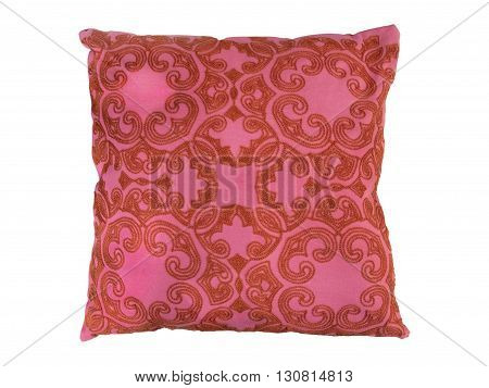 Red decorative pillow with a pattern of threads embroidered. Isolated on white background.