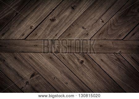 Dark brown wooden background. Old vintage surface
