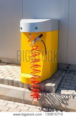 SAMARA RUSSIA - MAY 14 2016: Air pump at the Rosneft gas station in summer sunny day. Rosneft is one of the largest russian oil companies and gas stations