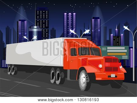 Red truck with white cargo container goes through the night city
