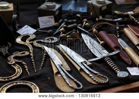 HRODNA BELARUS - MAY 21 2016: forged knifes and ornamental metal products in the souvenir shop in Grodno Belarus