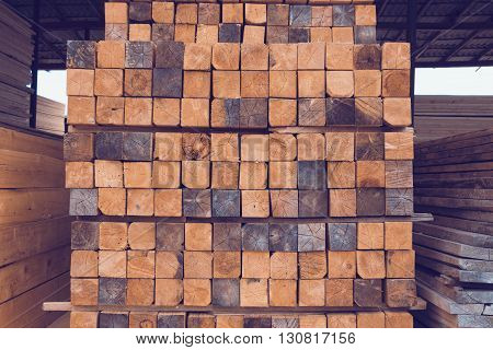 Closeup of stack of raw wooden planks