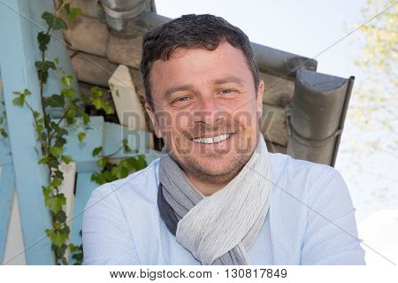 Closeup Of Handsome Guy Wearing Blue Shirt And Scarf