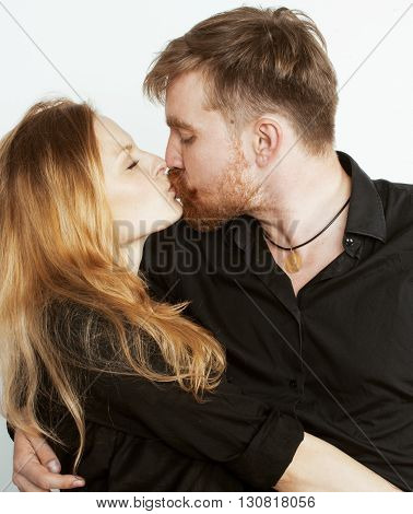 young tender couple, man and woman in love isolated on white, fooling around real modern hipster marriage concept