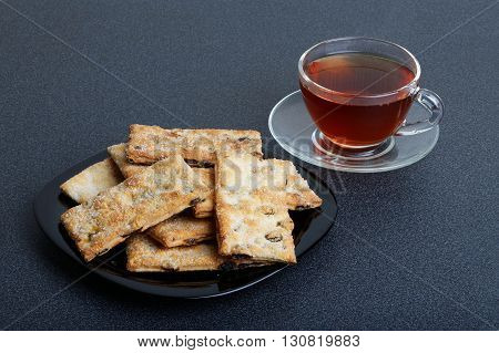 Puff Pastry With Raisins And Cup Of Tea