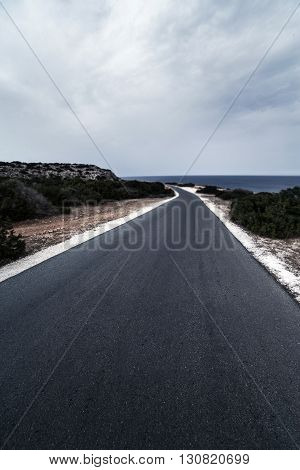 Asphalt road / Highland road / Asphalt road High way Empty curved road clouds