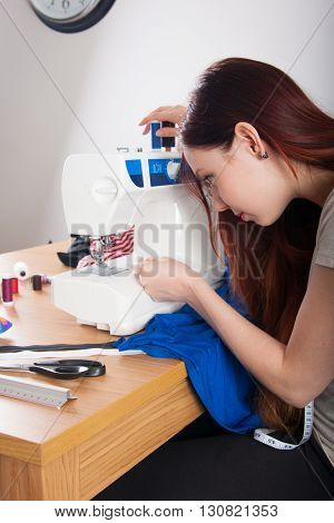 Woman Threading On Sewing Machine
