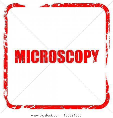 microscopy, red rubber stamp with grunge edges
