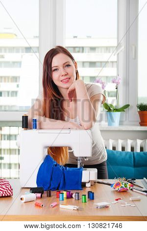 Young Woman Presenting Sewing Machine