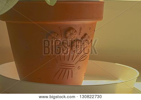 Clay flower pots and soil on a white pedestal
