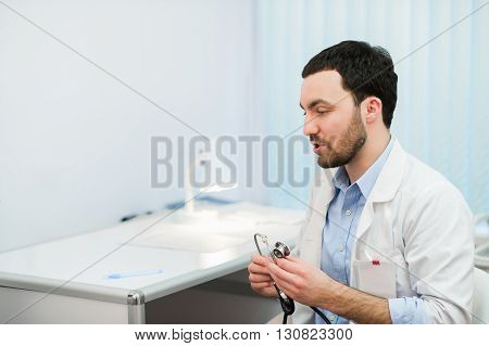 Doctor in consultation with patient sitting in front of him.