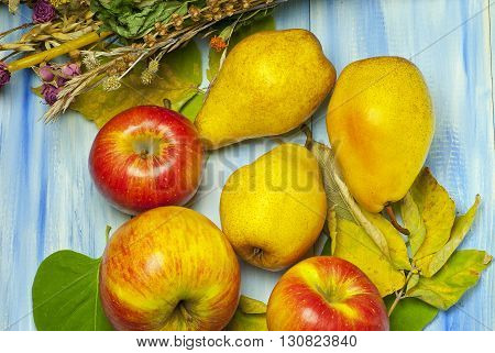 Ripe Apples And Pears On A Wooden Background
