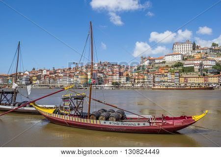 PORTO, PORTUGAL - APRIL 21, 2016: Traditional ship carrying port wine barrels in Porto, Portugal