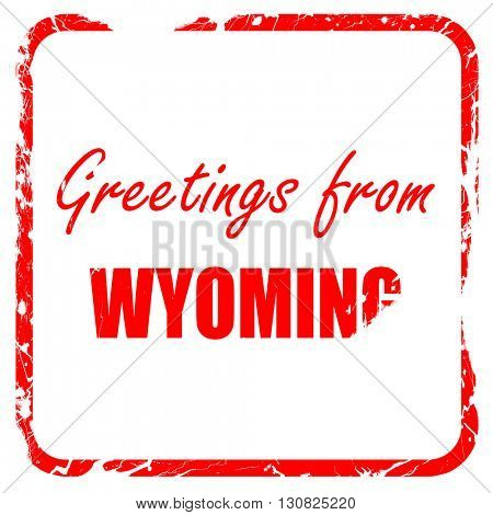 Greetings from wyoming, red rubber stamp with grunge edges