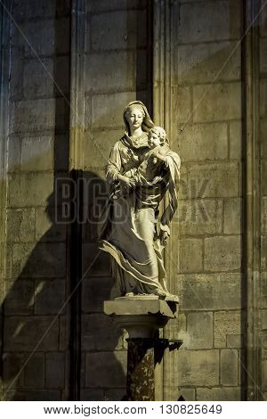 Paris, France - May 13: This is the statues of the Madonna with Christ at Notre-Dame de Paris May 13, 2013 in Paris, France.