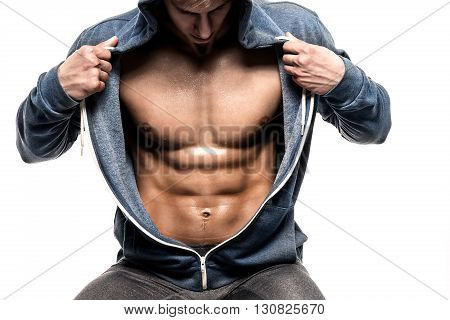 Handsome man with open jacket revealing muscular chest and abs, isolated on white background