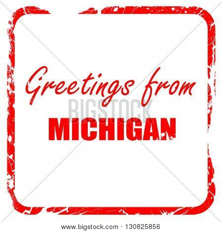 Greetings from michigan, red rubber stamp with grunge edges