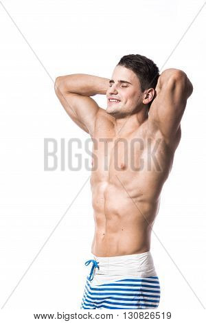 Young strong athlete on light background smiling