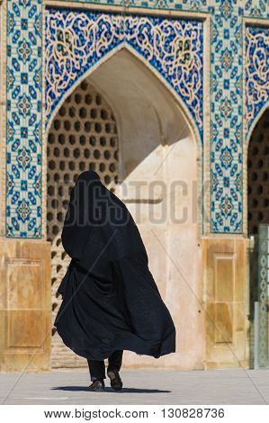 Esfahan Iran - February 2016 - Muslim woman with traditional chador on the street. Iran 2016