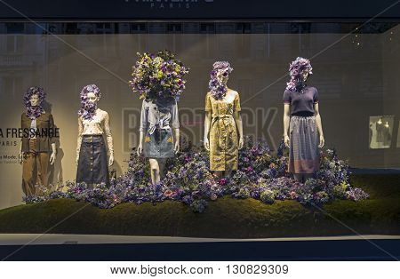 PARIS FRANCE - MAY 8 2016: Mannequins in the showcase of a department store in Paris France. Spring and summer theme.
