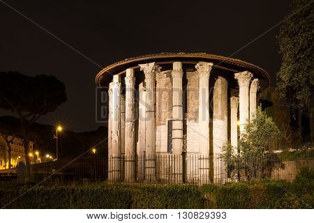 Roman hercules temple at night Rome Italy