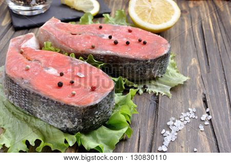 uncooked sockeye salmon steaks and ingredients on a table