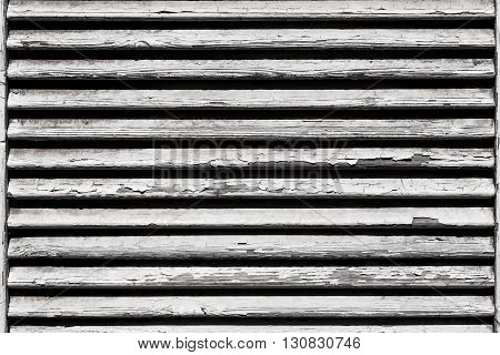 Image of white wooden shutters covering a window or door