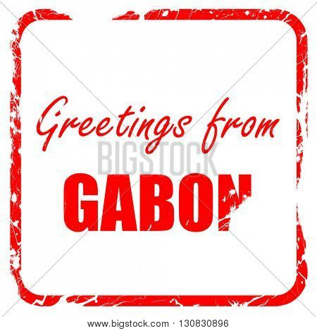 Greetings from gabon, red rubber stamp with grunge edges