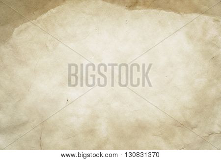 Aging paper background for the design. Natural old paper texture.