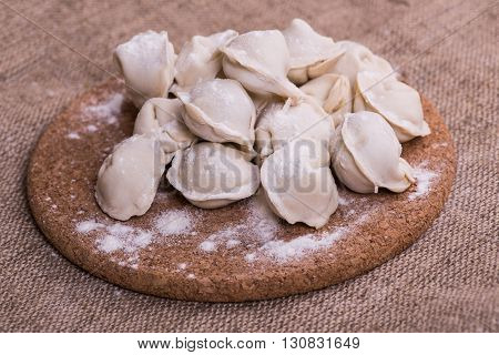 Siberian dish of small pockets of dough filled with seasoned, minced beef, lamb, or pork and served boiled