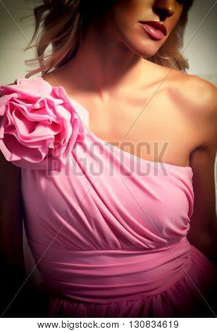 Beautiful blonde girl in evening dress pink