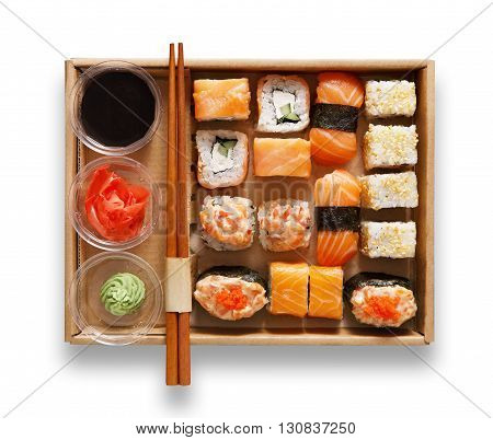 Japanese food restaurant, sushi maki gunkan roll plate or platter set. Chopsticks, ginger, soy sauce, wasabi. Sushi isolated at white background, take away, delivery box. Top view.