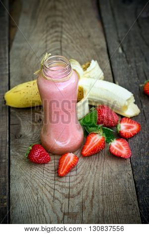 Homemade strawberry - banana smoothie in jar, refreshing and healthy beverage (drink)