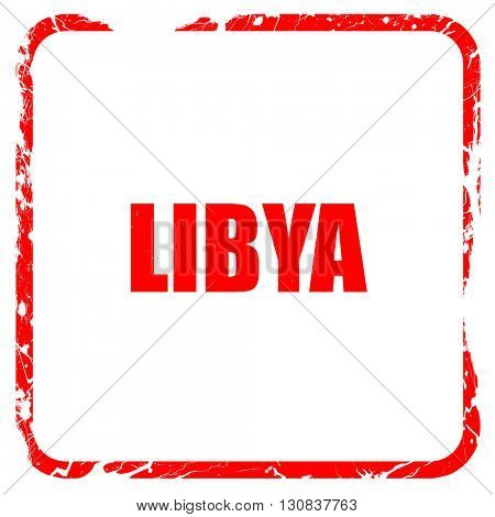 Greetings from libya, red rubber stamp with grunge edges
