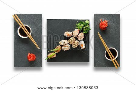 Japanese food restaurant, sushi gunkan plate or platter set. Set for two with chopsticks, ginger, soy sauce and wasabi. Sushi at black stone isolated at white background. Top view, Flat lay.