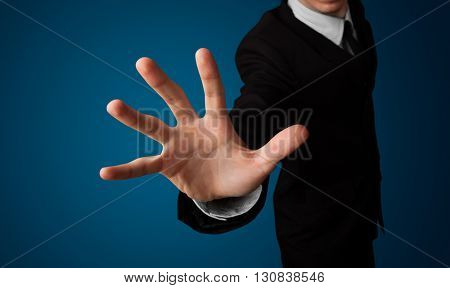 Young businessman pressing imaginary button