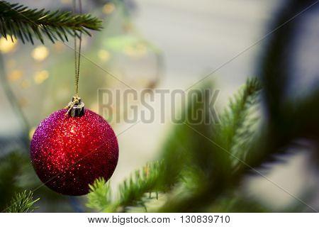 red christmas ball on the green tree - postcard