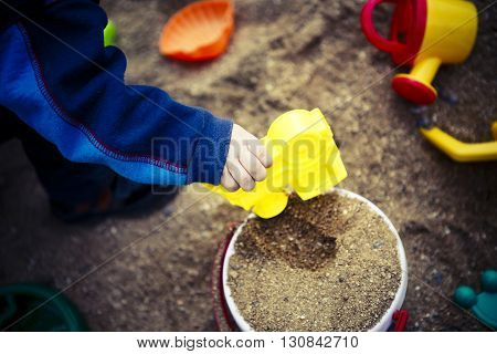 children toys on sand or beach - red and yellow