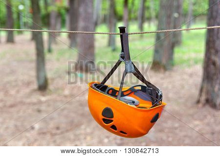 Climbing helmet hanging on the tense rope