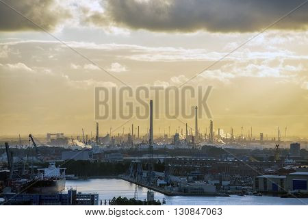 Industrial zone of Rotterdam shipyard at sunset