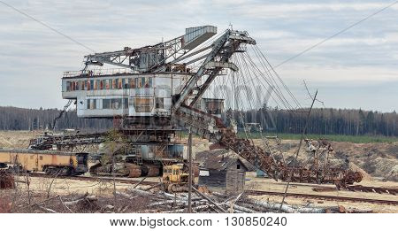 Many buckets of giant quarry excavator Equipment for the extraction of sand from the quarry.